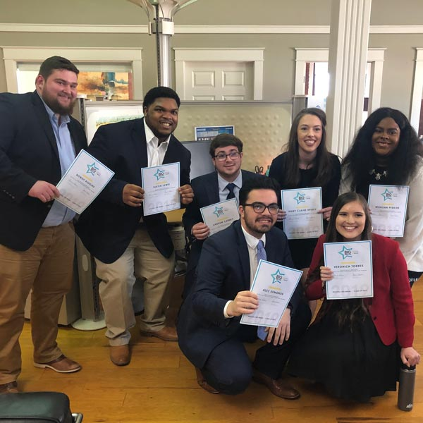 Big Break interns posing for photo with completion certificates